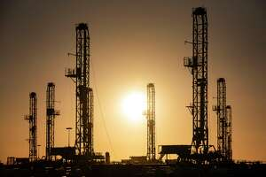 The morning sun rises behind oil rigs sitting in storage Saturday, Feb. 6, 2021 at a yard outside of Odessa, Texas. (Eli Hartman/Odessa American via AP)