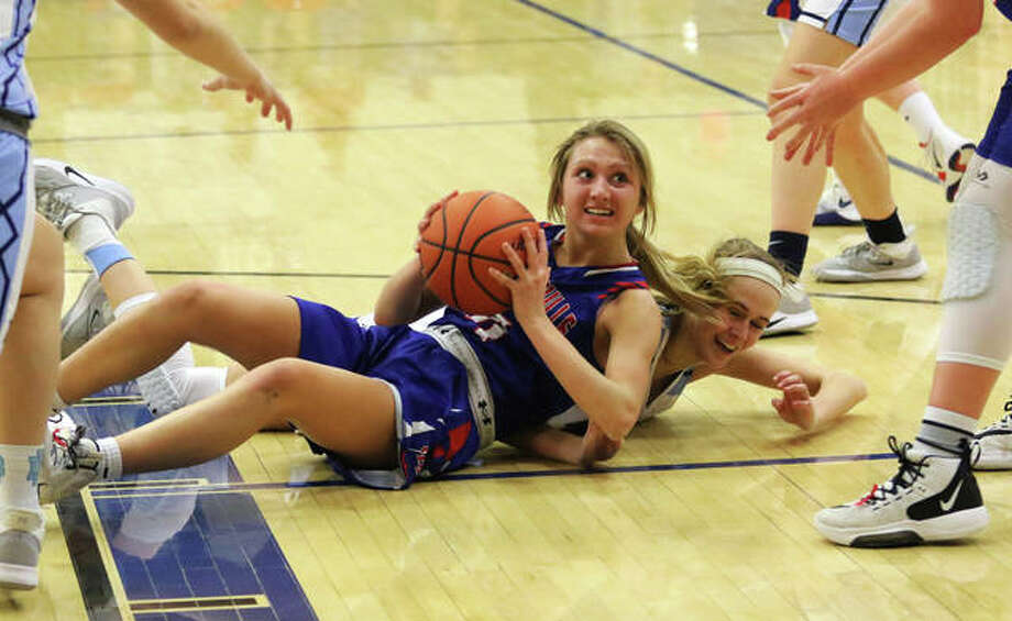 Carlinville's Jill Stayton, shown looking for a teammate after beating Mater Dei's Shannon Lampe to a loose ball in last season's Greenville Class 2A Sectional, scored 17 points Wednesday night in the Cavaliers' victory at North Greene. Photo: Greg Shashack / The Telegraph