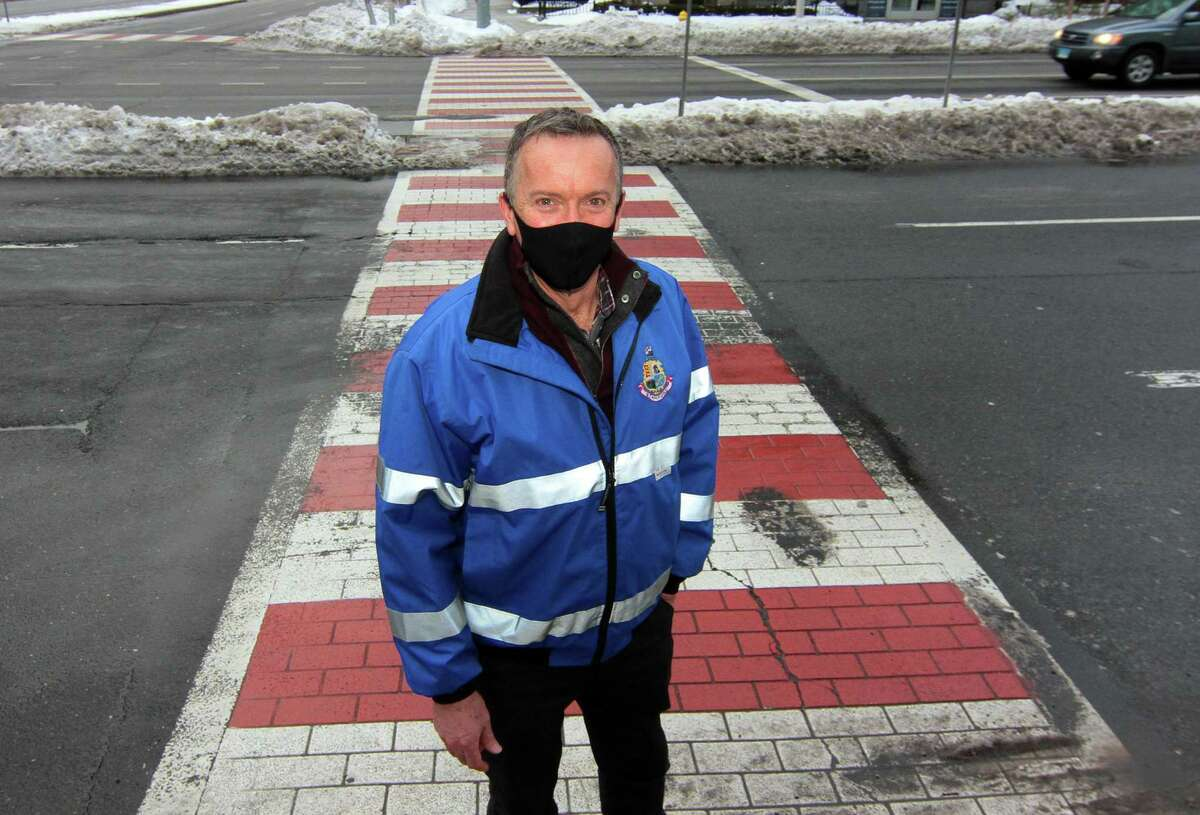 Stamford Transit Bureau Chief Jim Travers poses at the Stamford Government Center in Stamford, Conn., on Wednesday Feb. 3, 2021. Travers plans to leave Stamford for a new position in Norwalk.