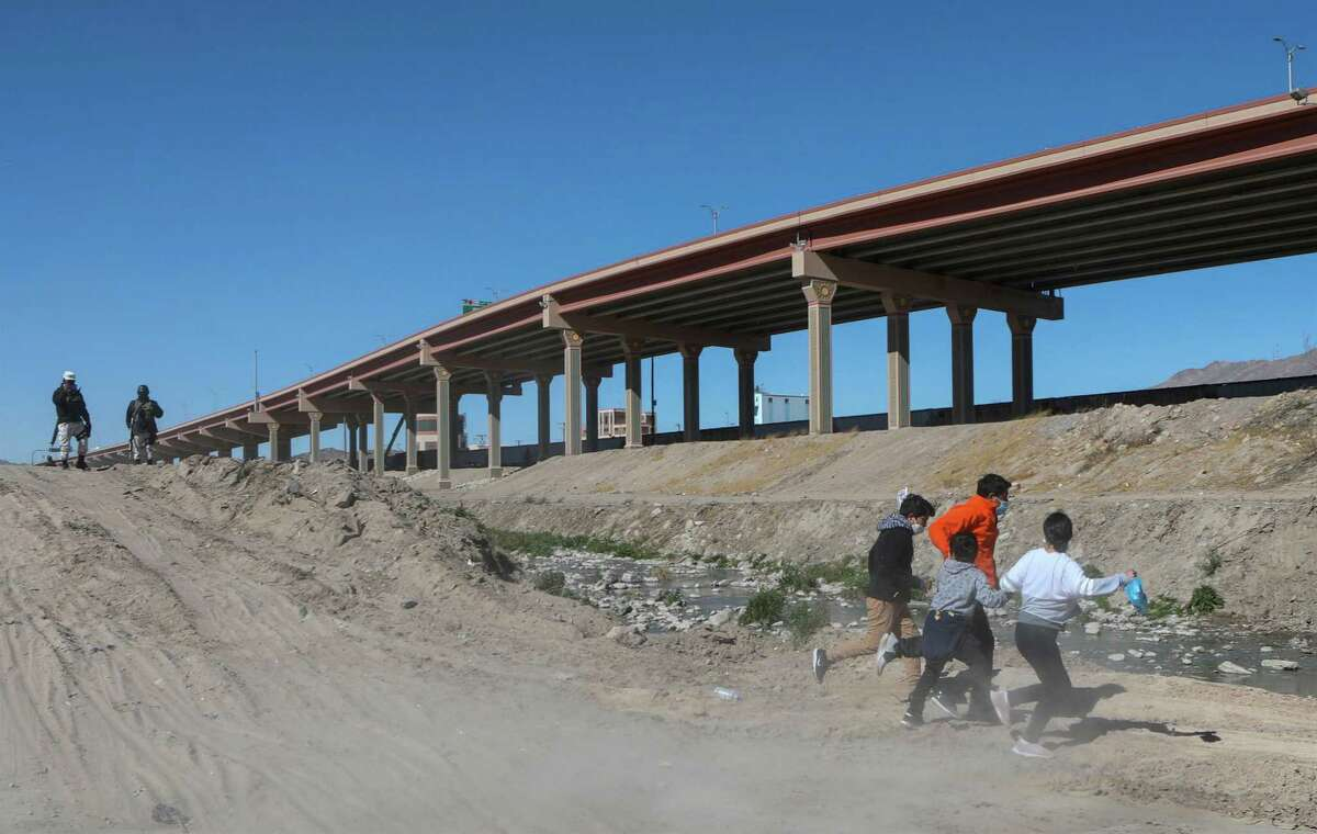 Migrants cross the Rio Bravo to get to El Paso, state of Texas, US, From Ciudad Juarez, Chihuahua state, Mexico on February 5, 2021.