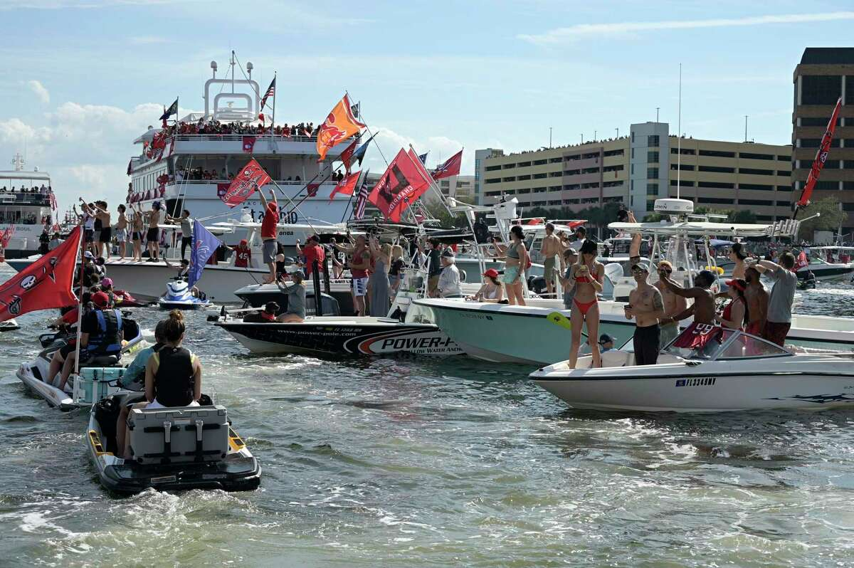 Buccaneers fans crowd the waterway on Wednesday.