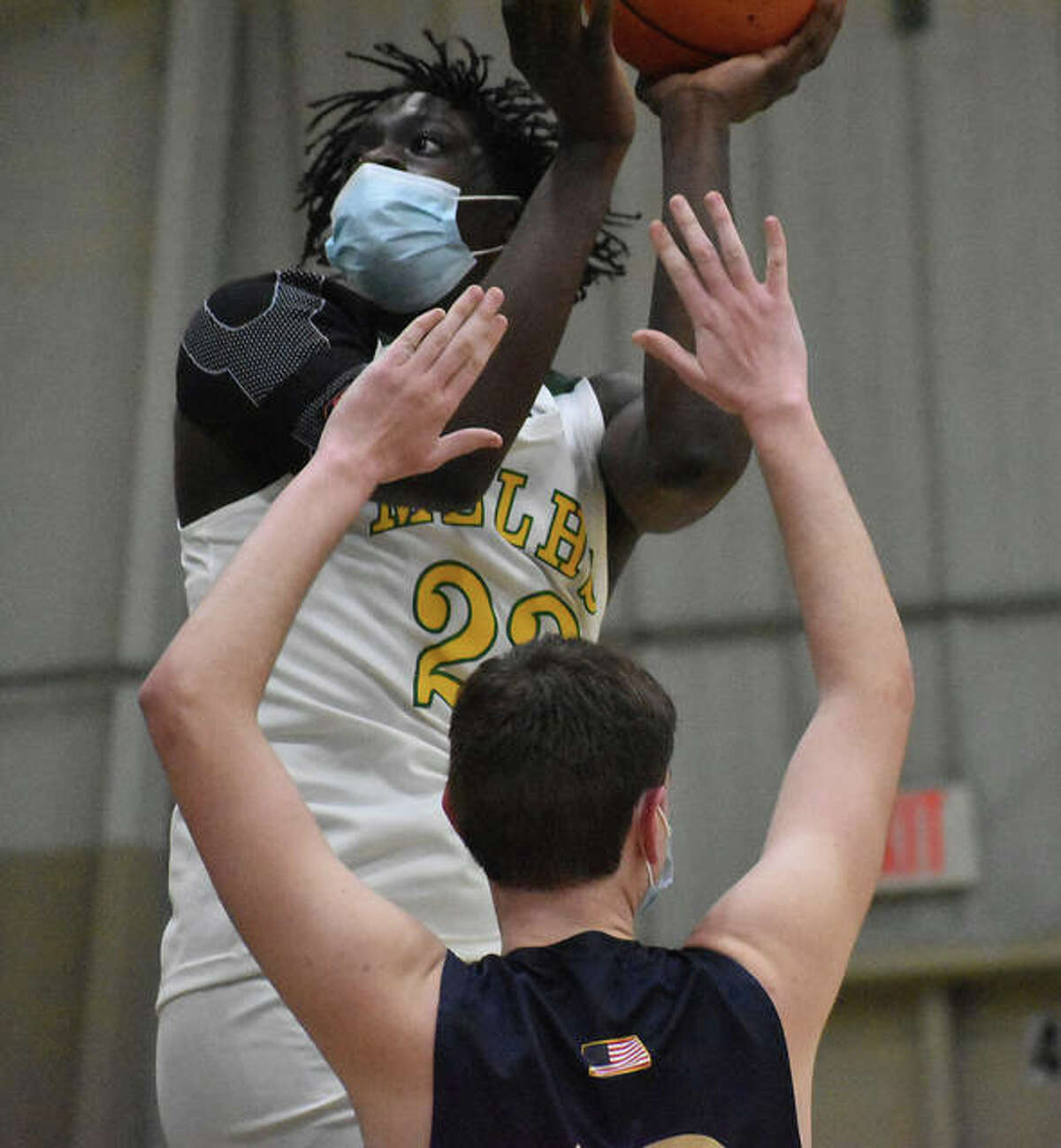 Metro-East Lutheran's DaMarcus Bean puts up a contested shot in the lane against Father McGivney.