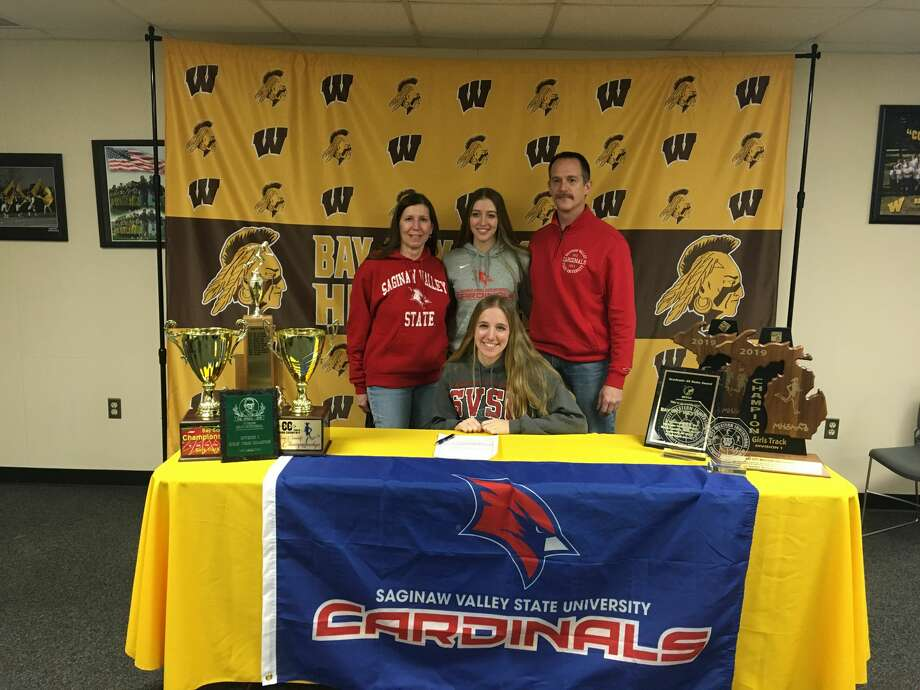 Karissa Picard is pictured with her family on signing day. Photo: Photo Provided