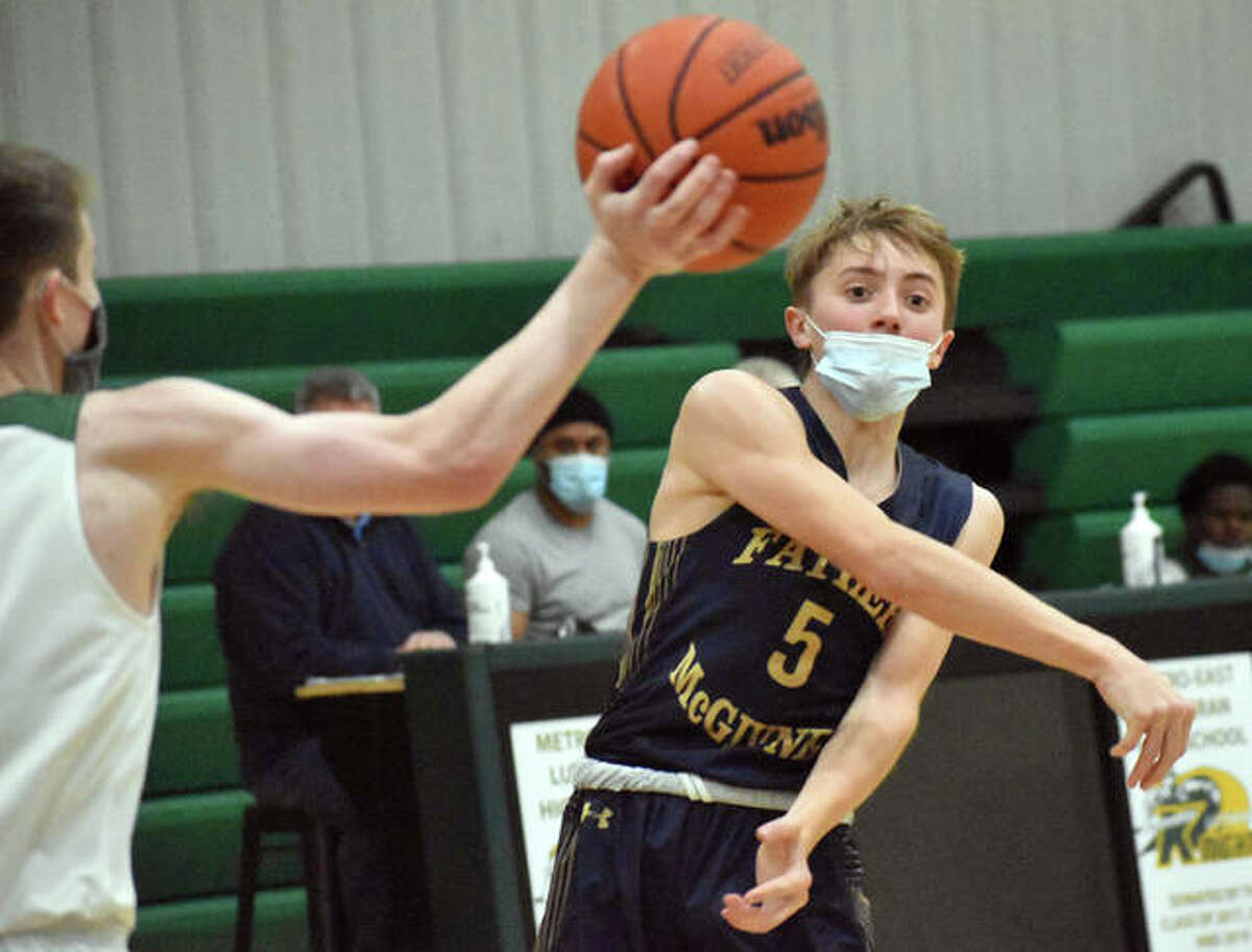 Father McGivney's Jacob Huber fires a pass across the court during Monday's game against Metro-East Lutheran.