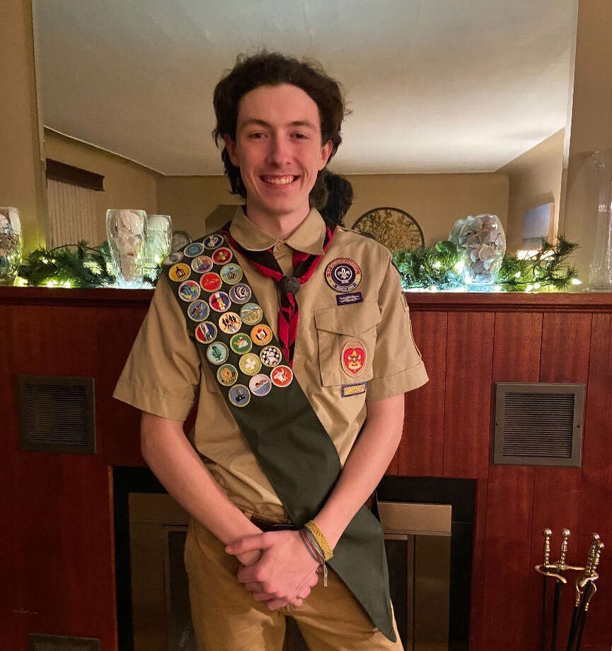 Midland High's Tanner Squires poses at his home on Jan. 28, 2021 after completing his Eagle Scout Board of Review evaluation with the Water and Woods Field Service Council of the Boy Scouts of America via a Zoom meeting. Photo: Photo Provided