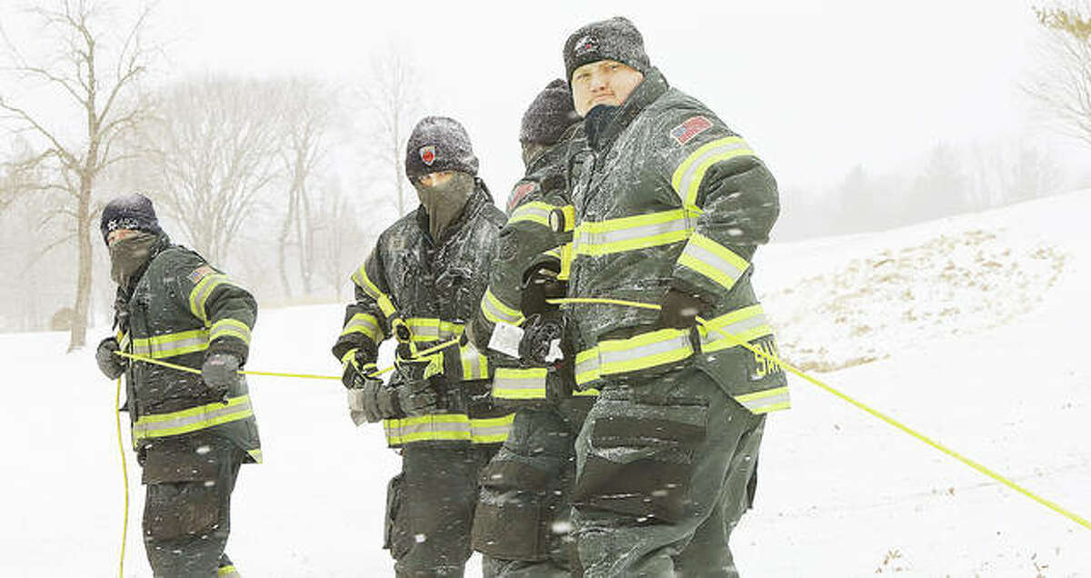It was heave-ho for four Alton firefighters as they manned the rope to pull both Fischer and his