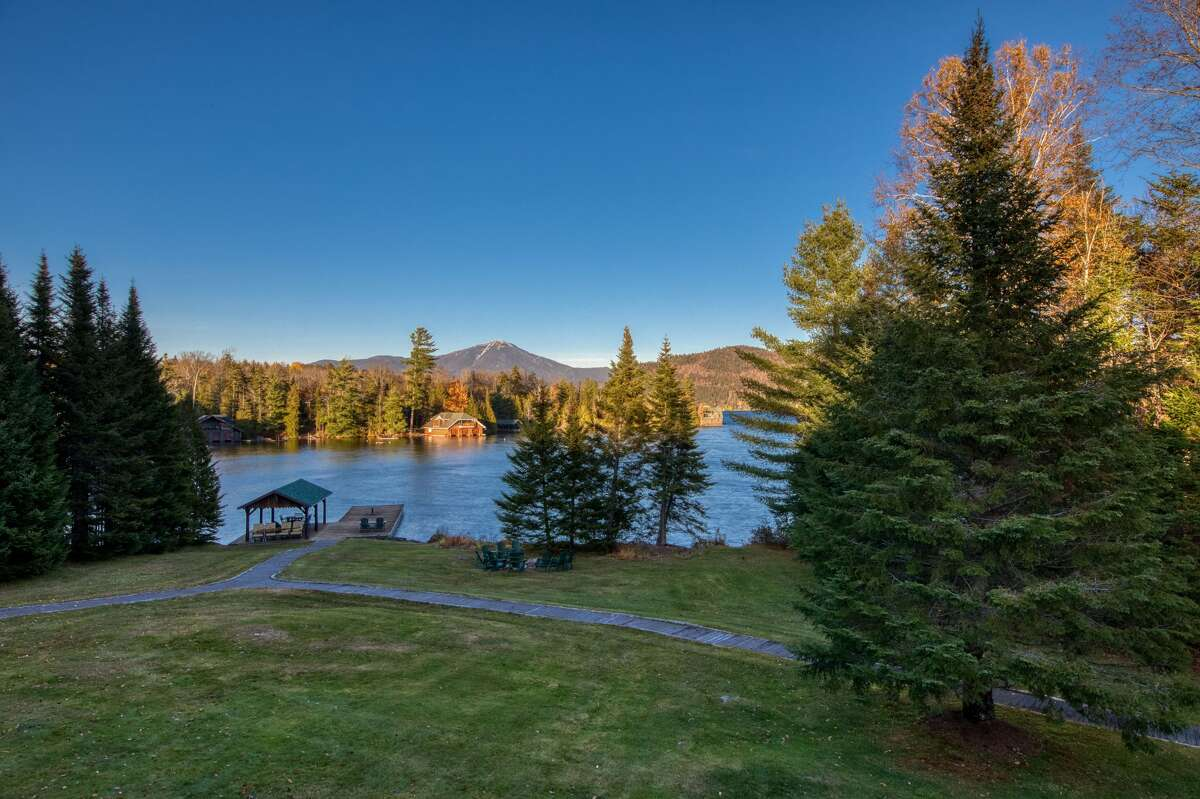 Built between 1998 and 2001 on the shore of Lake Placid, 62 Peninsula Point was designed to look like an Adirondack Great Camp. It has 10,000 square feet, eight bedrooms, an elevator, 2,500 feet of shoreline and sits on 23 acres.
