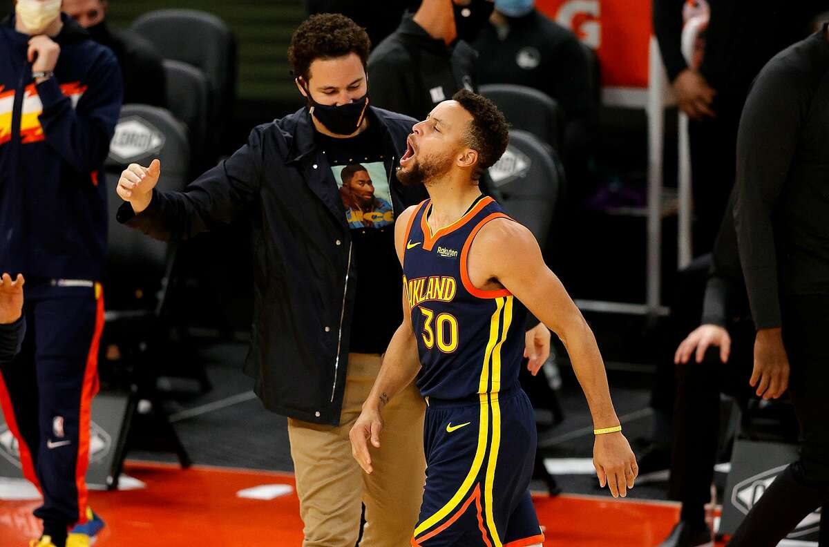 Stephen Curry #30 of the Golden State Warriors celebrates with Klay Thompson #11 after he made a three-point basket in the fourth quarter against the Minnesota Timberwolves at Chase Center on Jan. 25, 2021 in San Francisco, California. (Ezra Shaw/Getty Images/TNS)