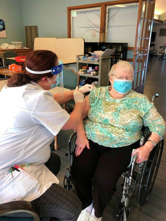 Scheurer's Long Term Care residents celebrated receiving their second dose of the Moderna COVID-19 vaccine on Feb. 3 with a 'Crushing COVID one shot at a time' themed party. (Courtesy Photo)