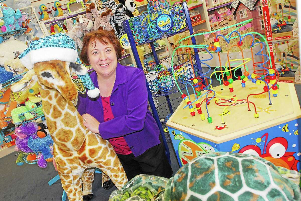 Diane Gervais, owner of Amato's Toy and Hobby in Middletown, is shown in this archive picture. The chamber recently selected the shop as its Retail Business of the Year.