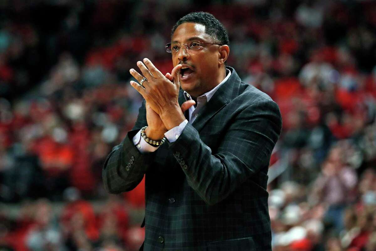 FILE - In this Saturday, Dec. 21, 2019, file photo, Texas-Rio Grande Valley coach Lew Hill claps after a play during the first half of an NCAA college basketball game against Texas Tech, in Lubbock, Texas. Texas Rio Grande Valley says Hill died Sunday, Feb. 7, 2021, a day after coaching a basketball game against Texas Southern. He was 55. (AP Photo/Brad Tollefson, File)