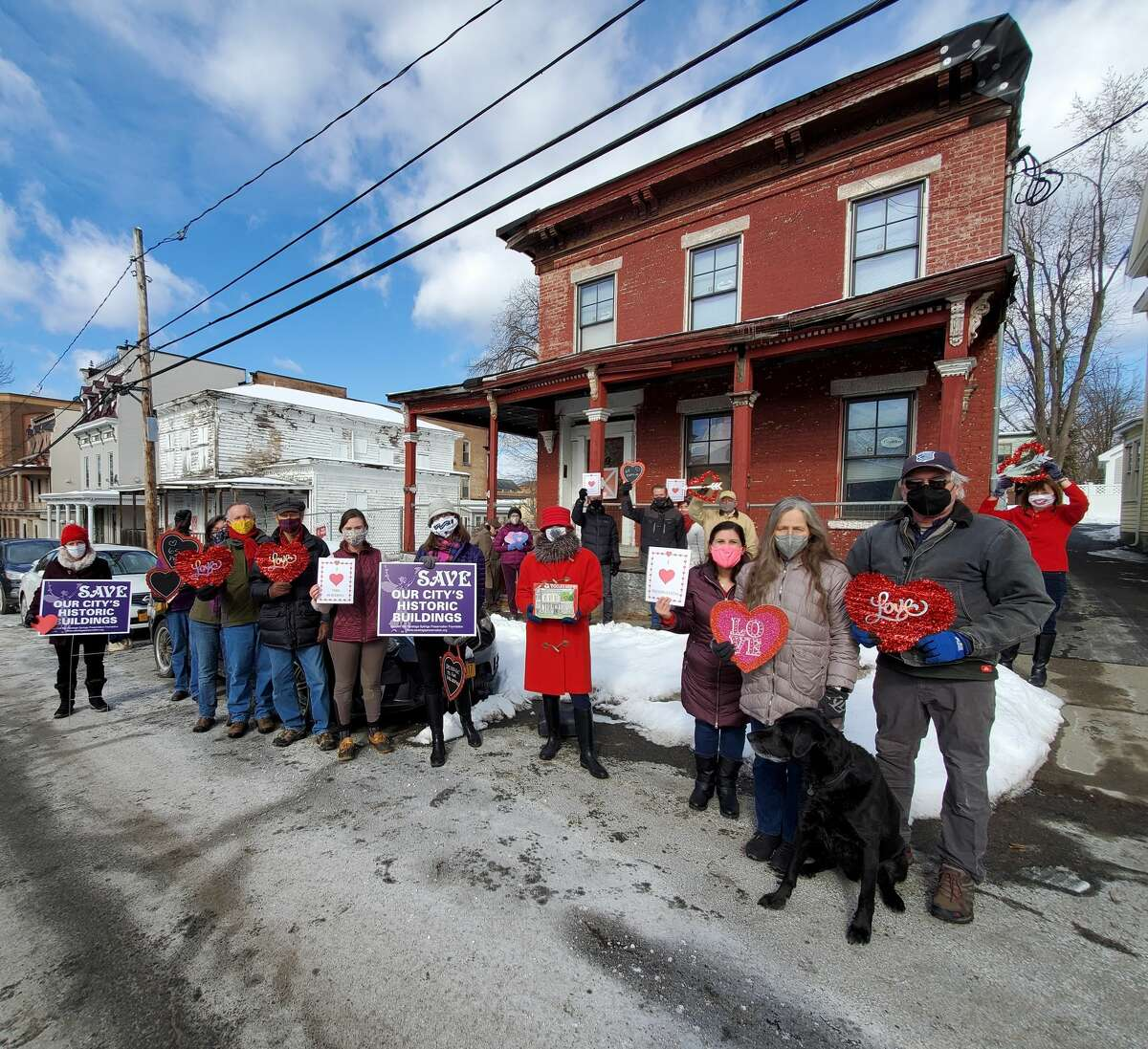 """Members of the Saratoga Springs Preservation Foundation gathered in front of 65 & 69 Phila Street in Saratoga Springs to show appreciation for unique historical architecture in the city as part of its """"Heart Bomb"""" Campaign on Thursday, Feb. 11, 2020."""