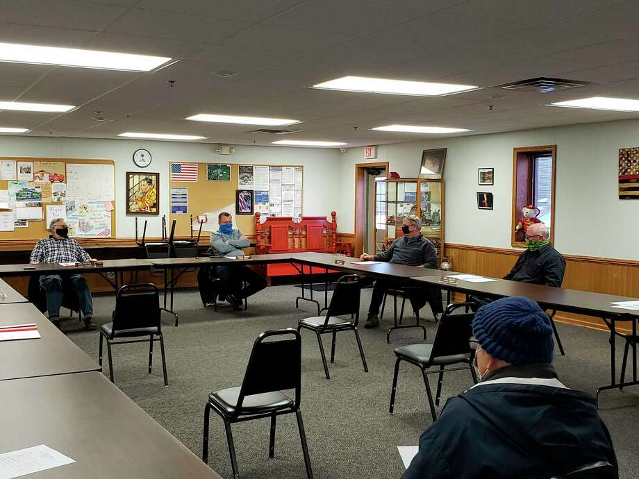 Members of the Caseville city council before their February meeting at the Caseville fire hall. (Robert Creenan/Huron Daily Tribune)