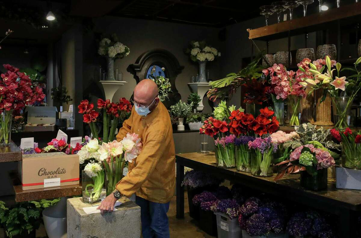 David Brown arranges the showroom at his flower shop ahead of Valentine's Day weekend.