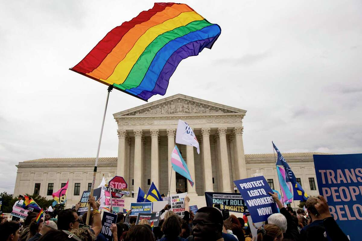 LGBTQ advocates rallied outside the Supreme Court in 2019 in support of protecting the transgender community from workplace discrimination. The same principles should apply to sports.