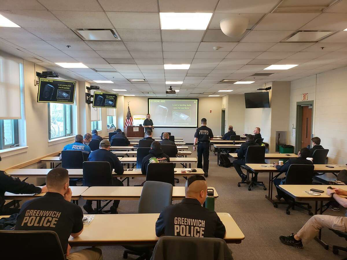 Instructors from Axon Enterprise give the presentations on body cameras to officers at Greenwich police headquarters this week.