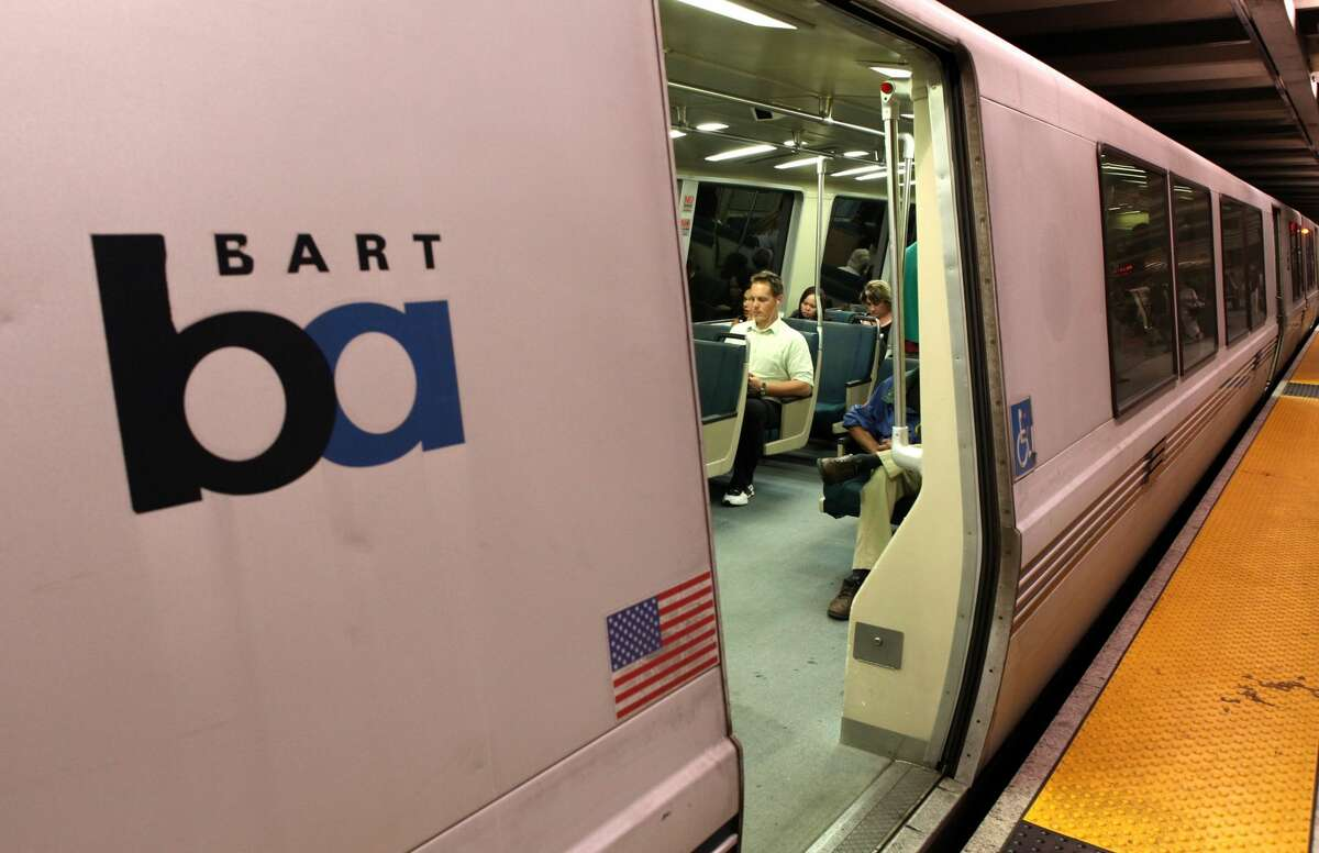 Bay Area Rapid Transit (BART) customers sit on a train at the Embarcadero station in San Francisco, California.