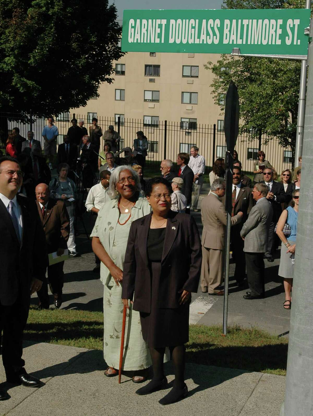 Thursday, Sept. 8, 2005, Troy, NY, A portion of 8th and Federal streets were been renamed Garnet Douglass Baltimore Street to honor the distinguished civil engineer and landscape designer, who was the first African American to earn a bachelor's degree from RPI. Garnet Baltimore was born and lived his life in Troy and designed and engineered Troy's Prospect Park, and Oakwood Cemetery, and still has local relatives in the community. L-R: At the unveiling of the street sign were then-Troy Mayor Harry Tutunjian;Baltimore's first cousin, three times removed, Jannie Daggs, of Cohoes, and RPI College President Shirley Ann Jackson, looking at the new sign. Baltimore was inducted to the Rensselaer Alumni Hall of Fame the following day, Sept. 9, 2005.LUANNE M. FERRIS / TIMES UNION