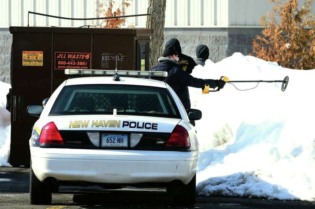 New Haven Police investigate an area on Washington Avenue in North Haven near the Best Western Plus with K-9s and metal detectors on February 11, 2021.