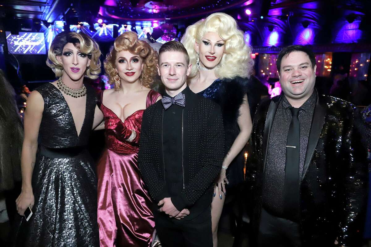 Sky Casper poses with drag performers. Casper is a events producer and agent focusing on LGBTQ+ talent.