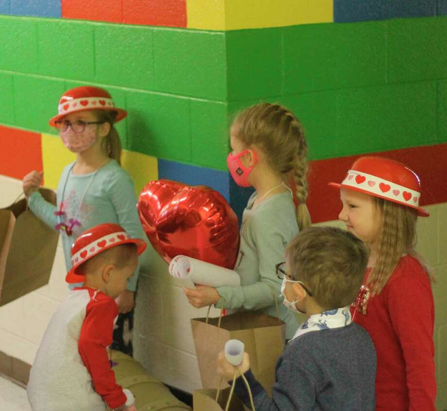 Kindergarten and preschool students at Trinity Lutheran School find the treasure chest of the Valentine Pirate on Thursday. (Kyle Kotecki/News Advocate)
