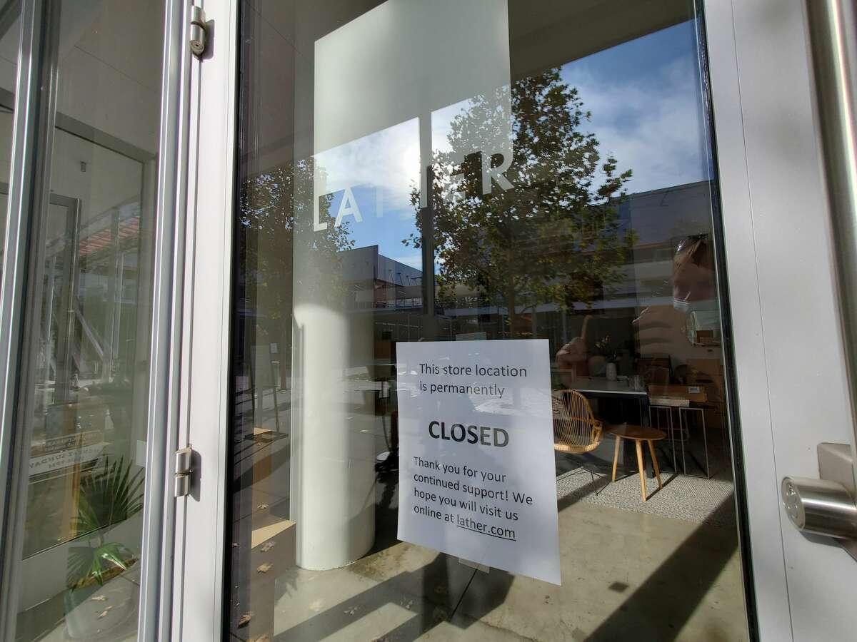 Close-up shot of a closure notice posted on the entrance of a Lather store in San Ramon, Calif.