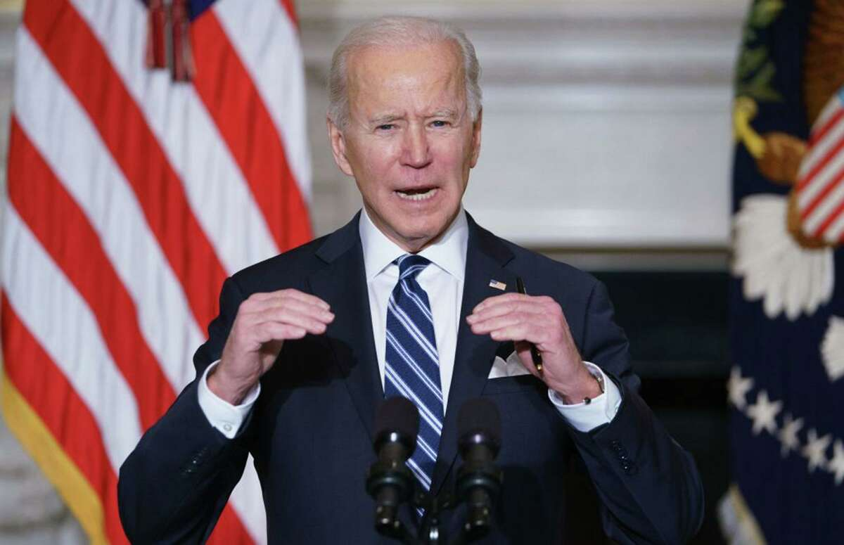 US President Joe Biden speaks on climate change, creating jobs and restoring scientific integrity before signing executive orders in the State Dining Room of the White House in Washington, DC on Jan. 27.
