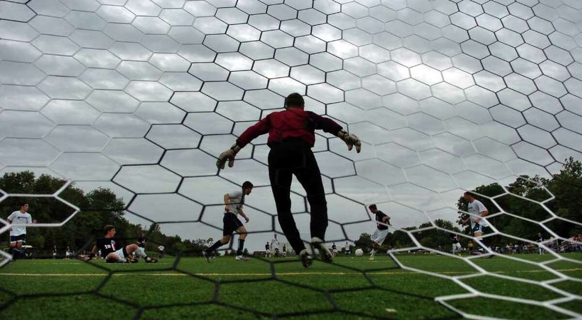 Storm clouds cover the sky, as Weathersfield goalie Billy Schmid stands ready to block a Staples goal attempt, during a soccer scrimage game at Wakeman Field in Westport, Conn. On Friday September 3, 2010. Hurricane Earl passed by with minimal interuption.