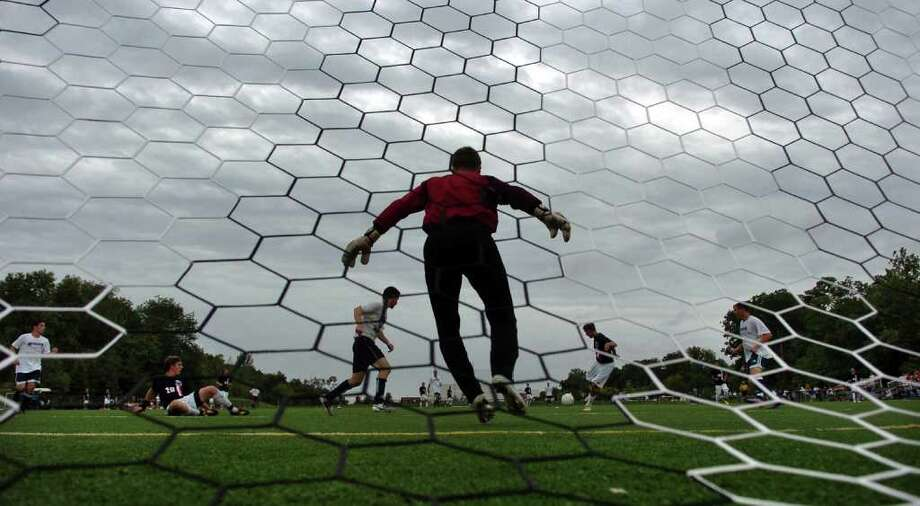 Storm clouds cover the sky, as Weathersfield goalie Billy Schmid stands ready to block a Staples goal attempt, during a soccer scrimage game at Wakeman Field in Westport, Conn. On Friday September 3, 2010. Hurricane Earl passed by with minimal interuption. Photo: Christian Abraham / Connecticut Post