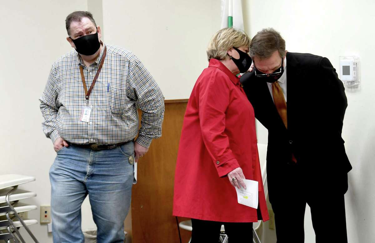 Mayor Becky Ames confers with Jefferson County Judge Jeff Branick during a joint press conference Monday to discuss the team effort being used to prepare for and obtain COVID-19 vaccine. Photo taken Monday, January 25, 2021 Kim Brent/The Enterprise