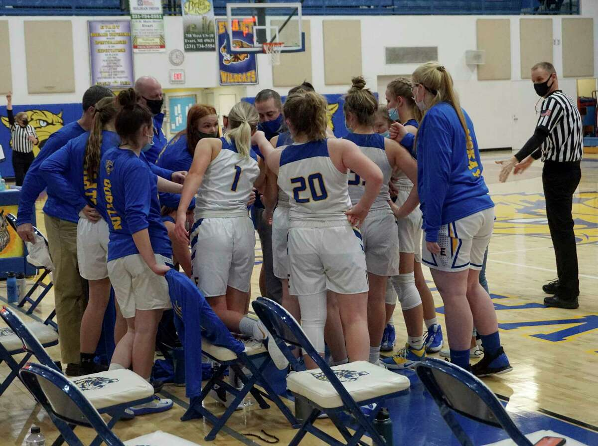 Evart girls' basketball coach Matthew Tiedt (center of huddle) speaks to his players during a timeout in Wednesday night's game against McBain Northern Michigan Christian. (Pioneer photo/Joe Judd)