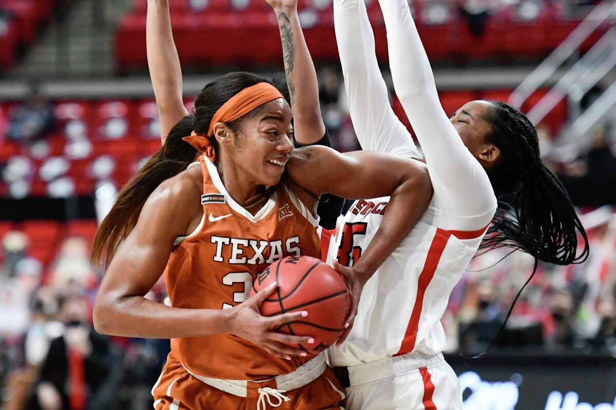 Texas junior center Charli Collier, left, scored her 1,000th career point on a fourth-quarter layup vs. Oklahoma State.