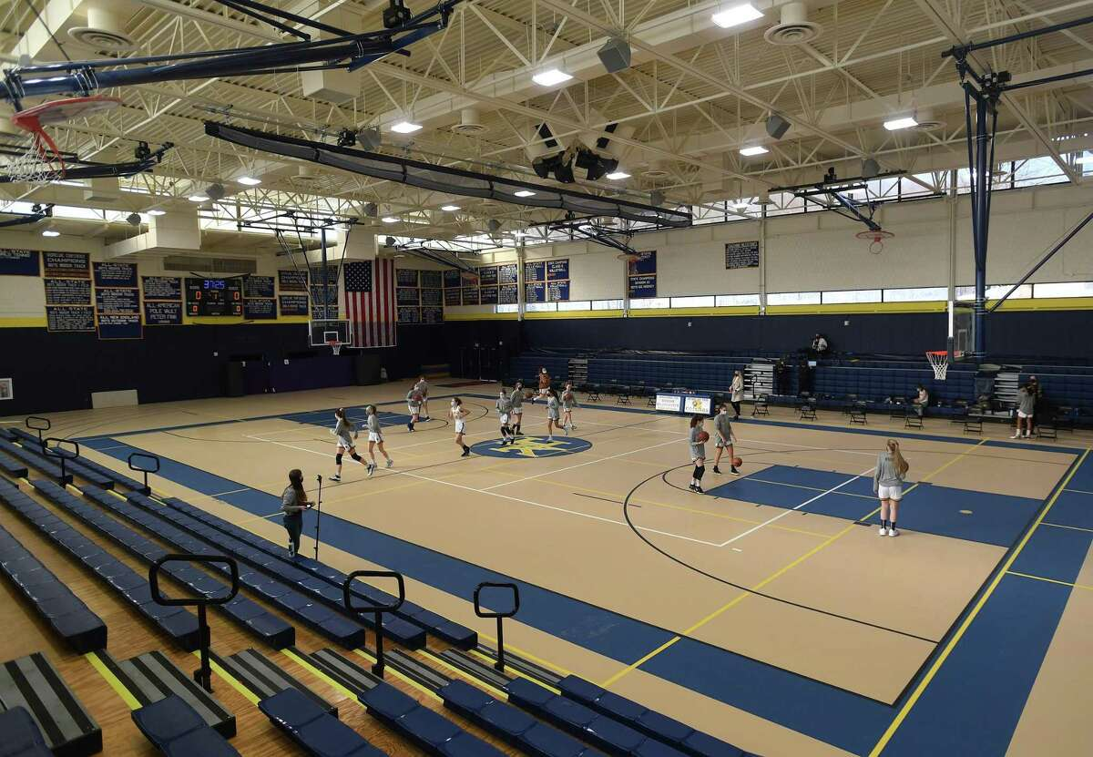 A new floor, bleachers, and sound system are among the many new upgrades to the field house at Haddam-Killingworth.