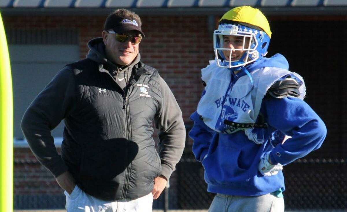 Mike Forget, left, who was named the interim coach of the Darien football program last February, is now the head coach of the Blue Wave, athletic director Chris Manfredonia confirmed on Thursday.
