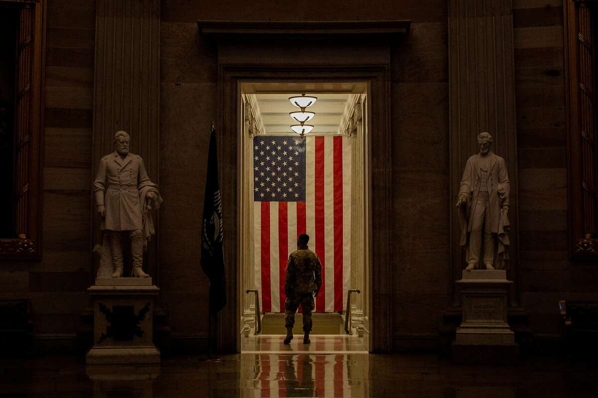 A National Guard member stands inside the rotunda of the Capitol on the second day of the second Senate impeachment trial of Donald Trump.