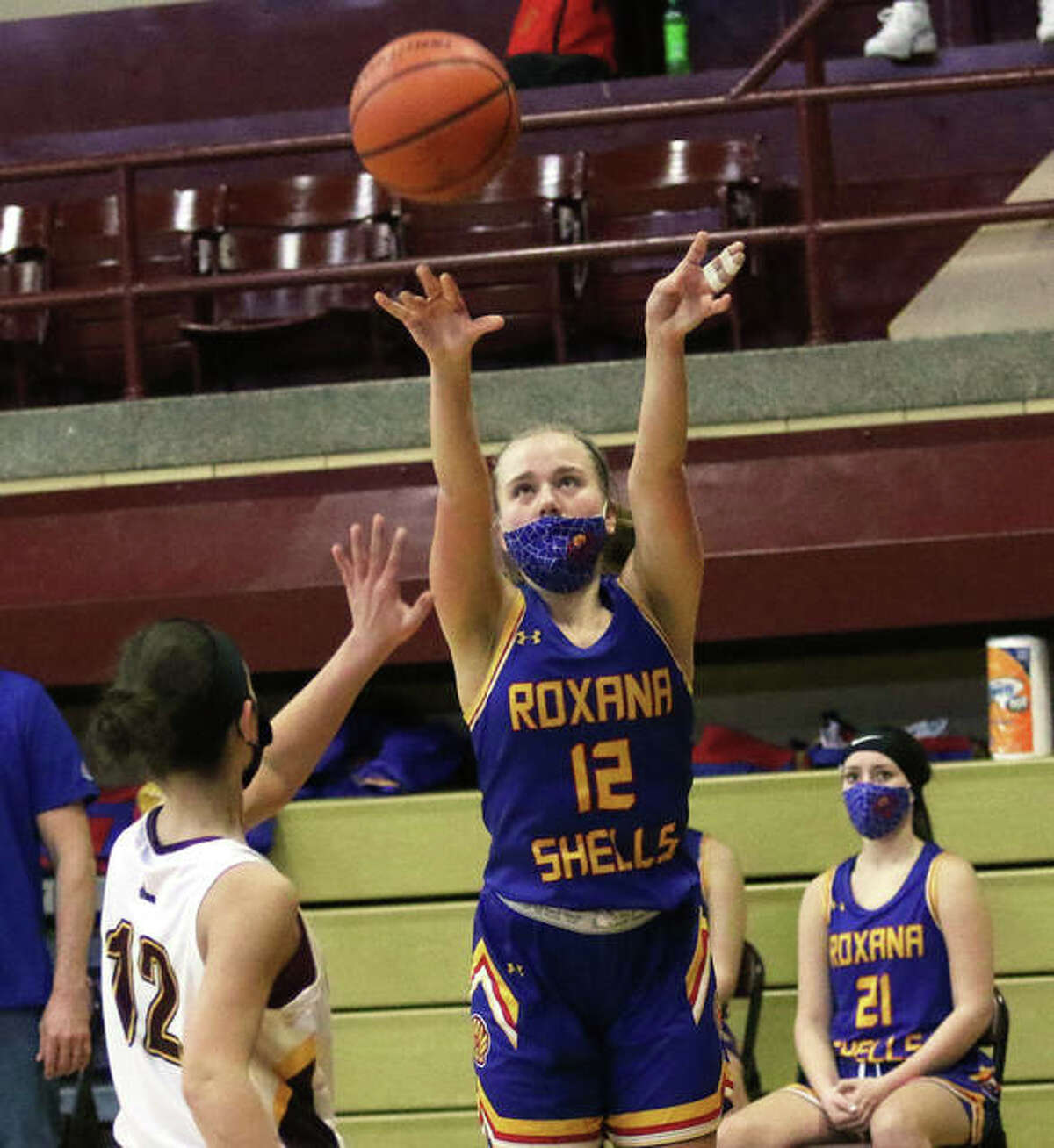 Roxana's Olivia Mouser scores two of her game-high 20 points against EA-WR last Saturday in Wood River.