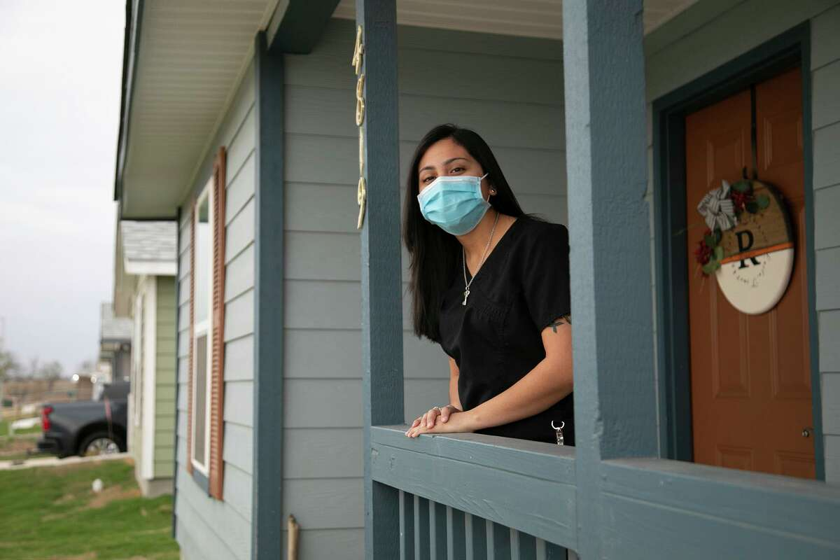 """Abigail Ruggiero, in her Habitat for Humanity home, says """"we don't have to worry about where we're going to rent next or where we're going to go."""""""