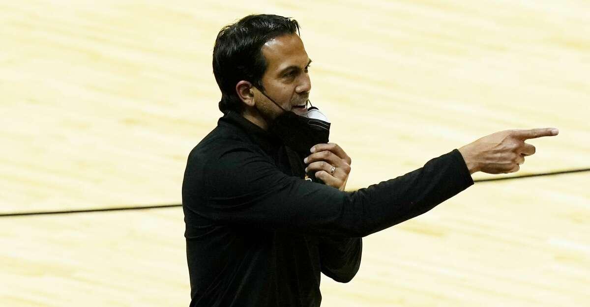 Miami Heat head coach Erik Spoelstra gestures during the first half of an NBA basketball game against the Washington Wizards, Friday, Feb. 5, 2021, in Miami. (AP Photo/Marta Lavandier)