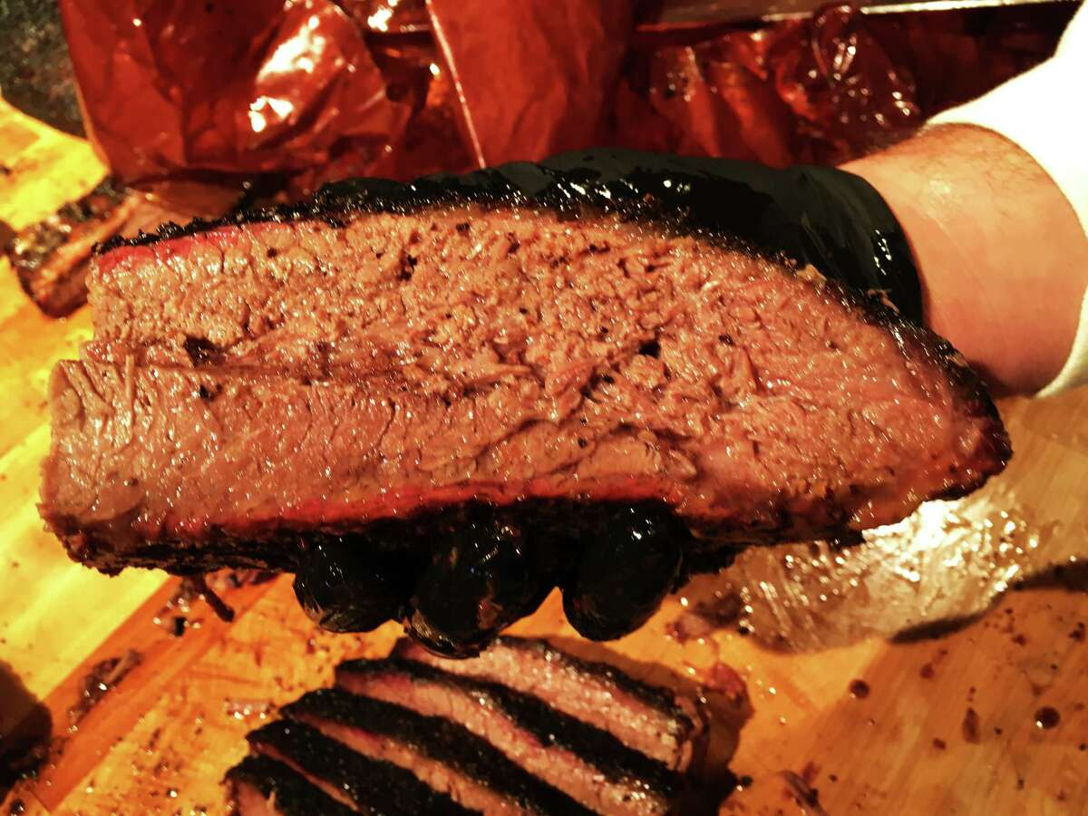 Briskets at Pinkerton's Barbecue are wrapped in butcher paper during the smoking process.
