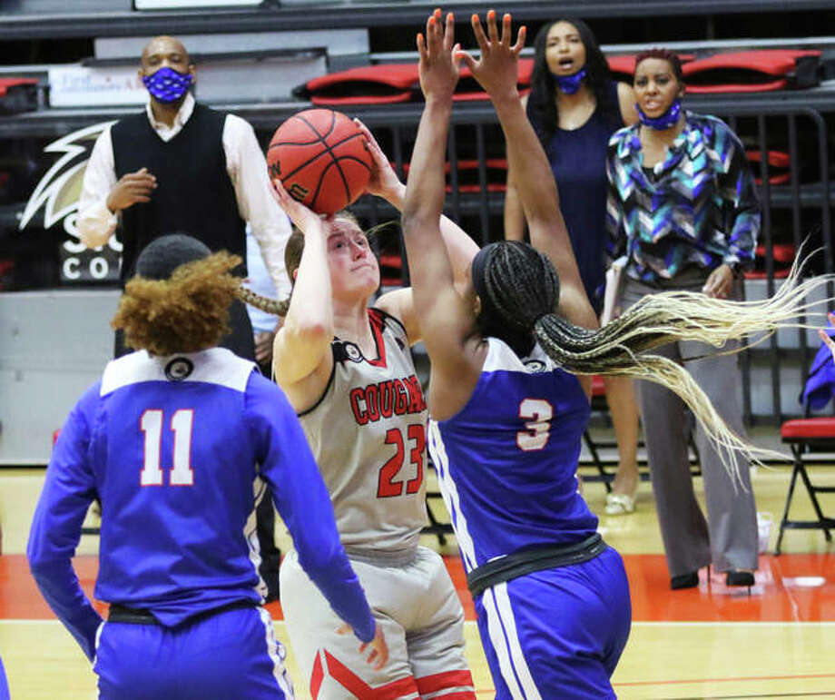 SIUE senior Allie Troeckler (23), shown shooting over a Tennessee State defender in a game last Thursday, was one of three Cougars to score a team-high six points in Thursday's loss at Tennessee Tech. Photo: Greg Shashack / The Telegraph