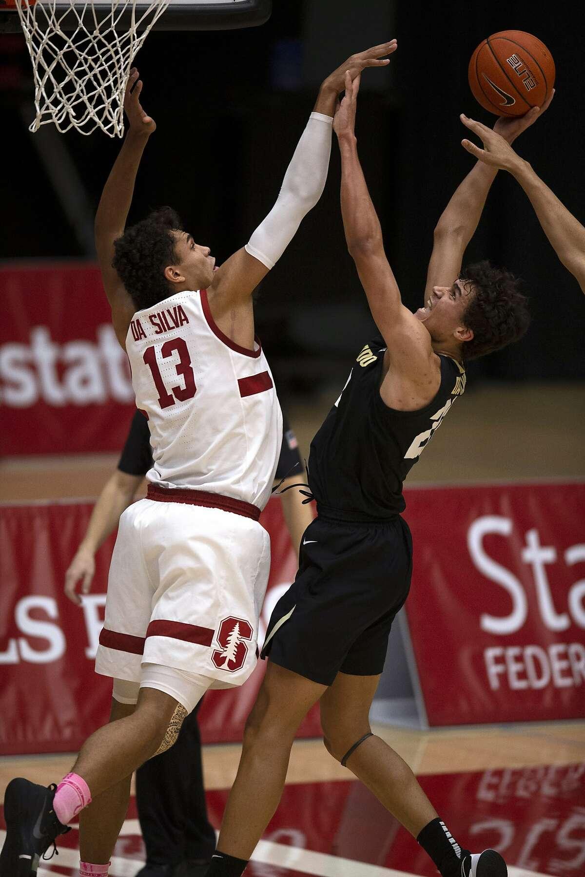 Colorado's Tristan da Silva (right) attempts to shoot over Stanford's Oscar da Silva during the Buffaloes' 69-51 win.