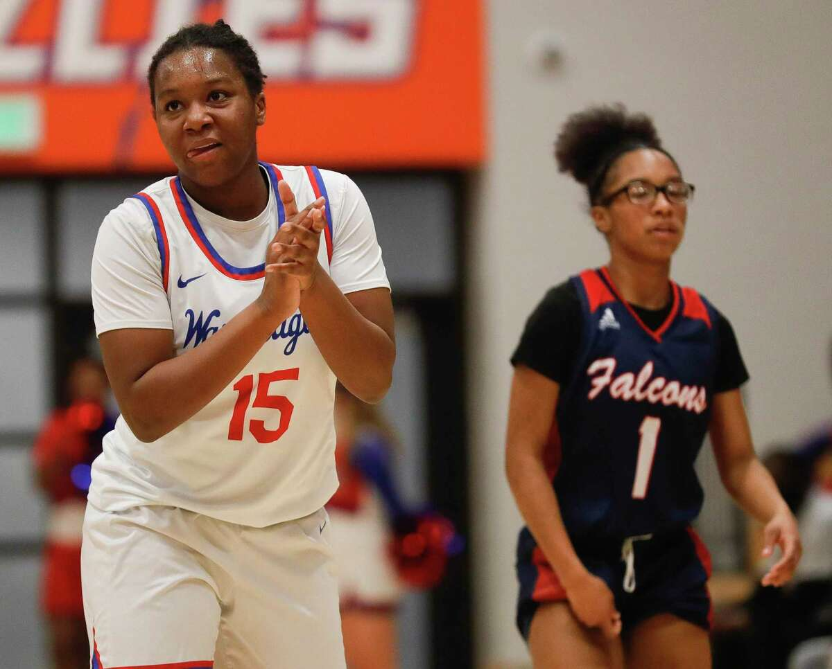 Oak Ridge's Allison Owens (15) reacts after a Aldine Davis turnover during the first quarter of a Region II-6A bi-district high school basketball playoff game at Grand Oaks High School, Thursday, Feb. 11, 2021, in Spring.