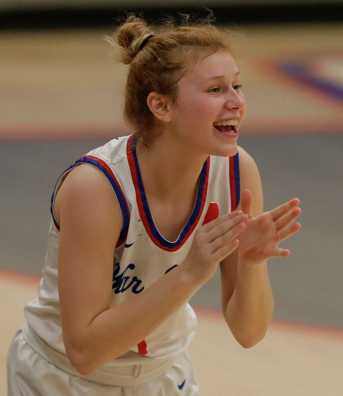 Oak Ridge's Nikki Petrakovitz (1) cheers from the bench during the first quarter of a Region II-6A bi-district high school basketball playoff game at Grand Oaks High School, Thursday, Feb. 11, 2021, in Spring.