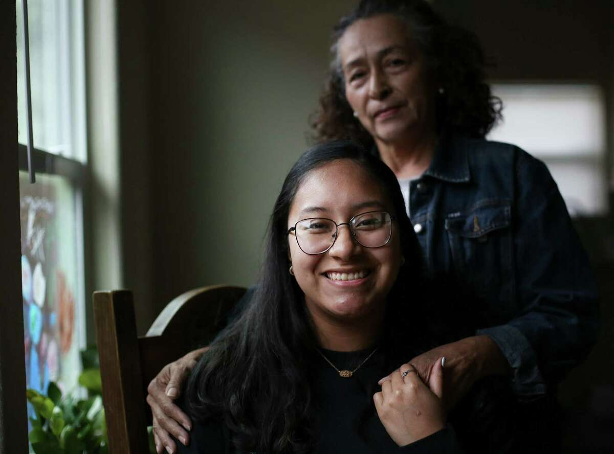 YES Prep East End senior Alondra Carmona with her mom, Martha Zepeda, in her sister's home in Houston on Thursday, Feb. 11, 2021. Carmona, who was accept into Barnard College, started a GoFundMe after giving her mom her college savings to help pay for rent when her mom told her had lost her job.