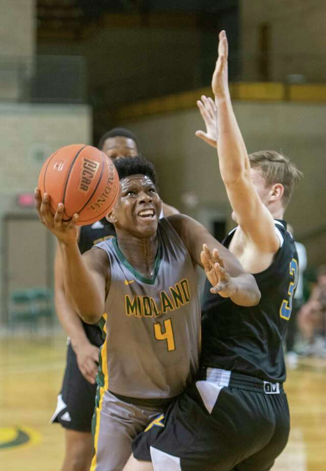 Midland College's Emanuel Prospere tries to get around Frank Phillips' Aiden Gair for a shot 02/11/2021 at the Chaparral Center. Tim Fischer/Reporter-Telegram Photo: Tim Fischer, Midland Reporter-Telegram