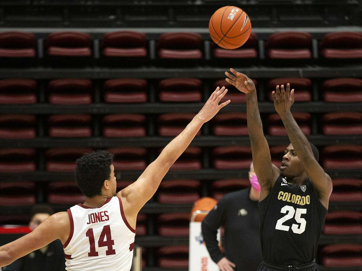 Colorado guard McKinley Wright IV (25) shoots over Stanford forward Spencer Jones (14) during the second half of an NCAA college basketball game, Thursday, Feb. 11, 2021, in Stanford, Calif. Colorado won 69-51. (AP Photo/D. Ross Cameron)