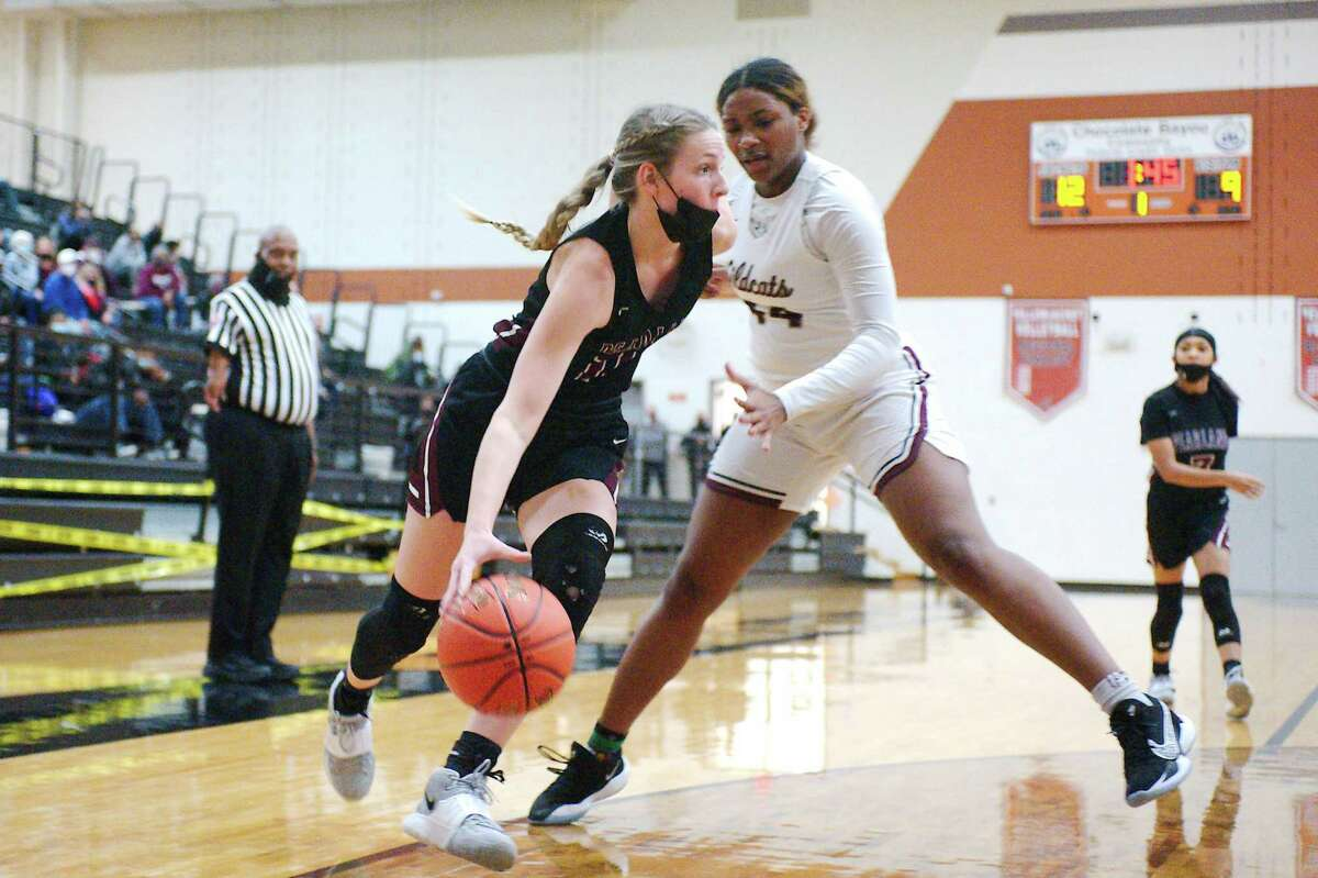 Pearland's Ashlynn Patrick (11) drives to the basket past Clear Creek's Eliya Ellis (44) Thursday at Alvin High School.
