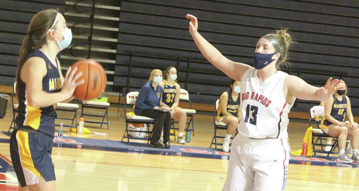 Rylie Haist (13) defends against the Manistee offense in Wednesday basketball action. (Pioneer photo/John Raffel)