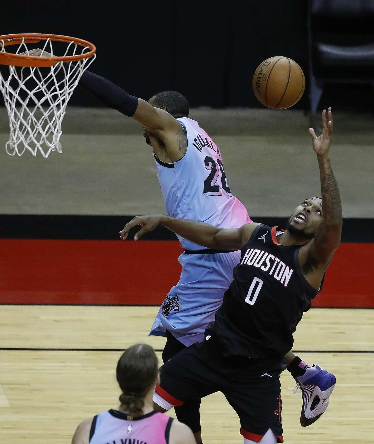 Houston Rockets guard Sterling Brown (0) goes up for a rebound against Miami Heat forward Andre Iguodala (28)during the second half of an NBA basketball game at Toyota Center, in Houston, Thursday, February 11, 2021.