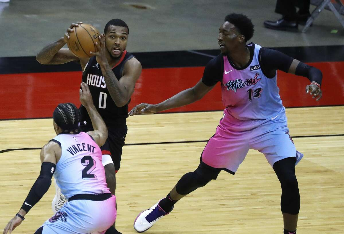Heat center Bam Adebayo (right) is among the notable Miami names expected to miss Monday's game against the Rockets.